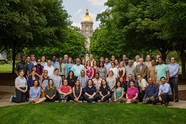 Participants in the 2016 Summer Institute pose for a picture in front of the famous University of Notre Dame dome.
